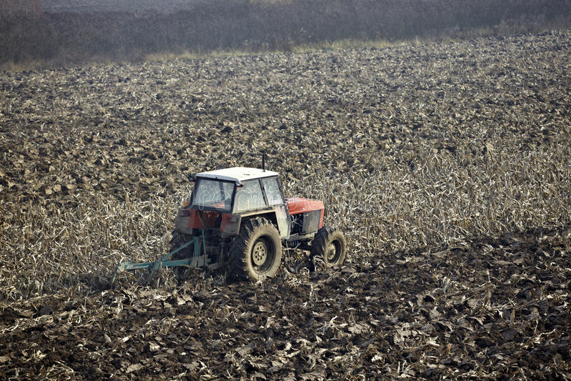 Agriculture tractor cultivated land stock photo