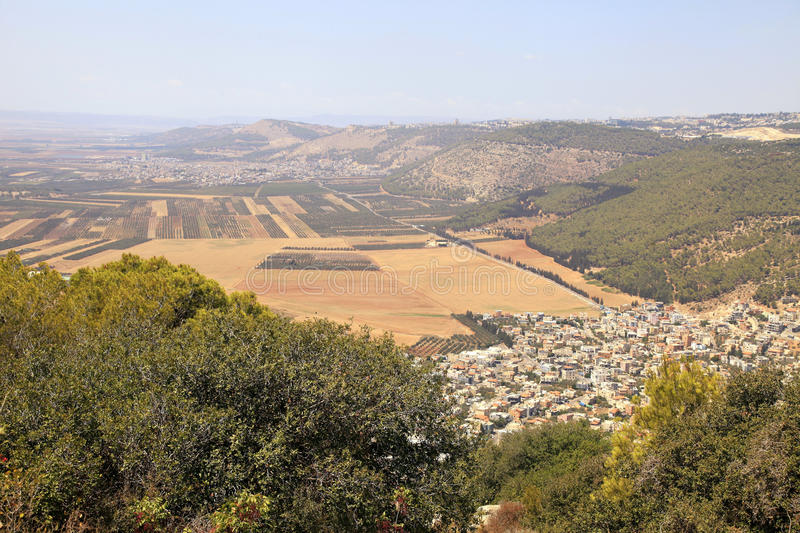 Agriculture valley with fields and arab village, Israel. Beautiful view on agriculture valley with fields and arab village, Israel. Aerial view from Mount Tabor stock image