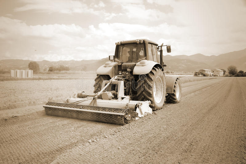 Agriculture, vintage farming tractor royalty free stock photos