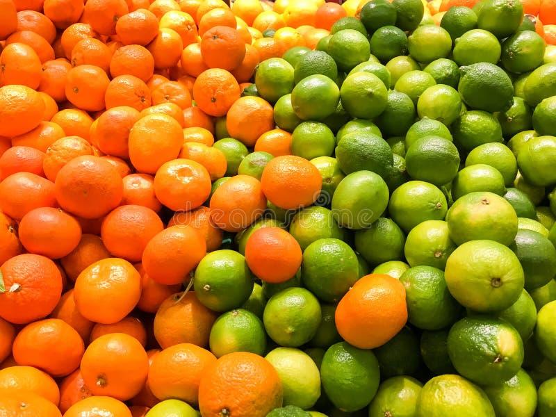 Agrios de la cal y de las mandarinas fotos de archivo