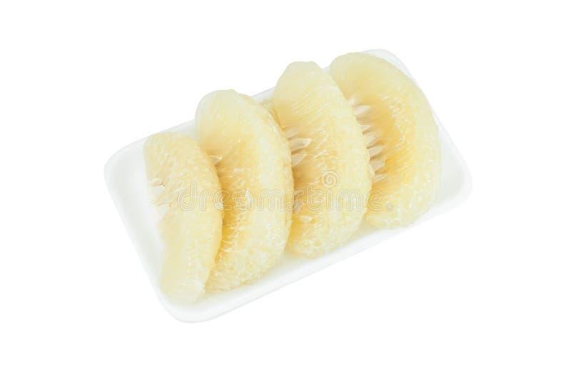 Agrios del pomelo en la espuma aislada en blanco imágenes de archivo libres de regalías