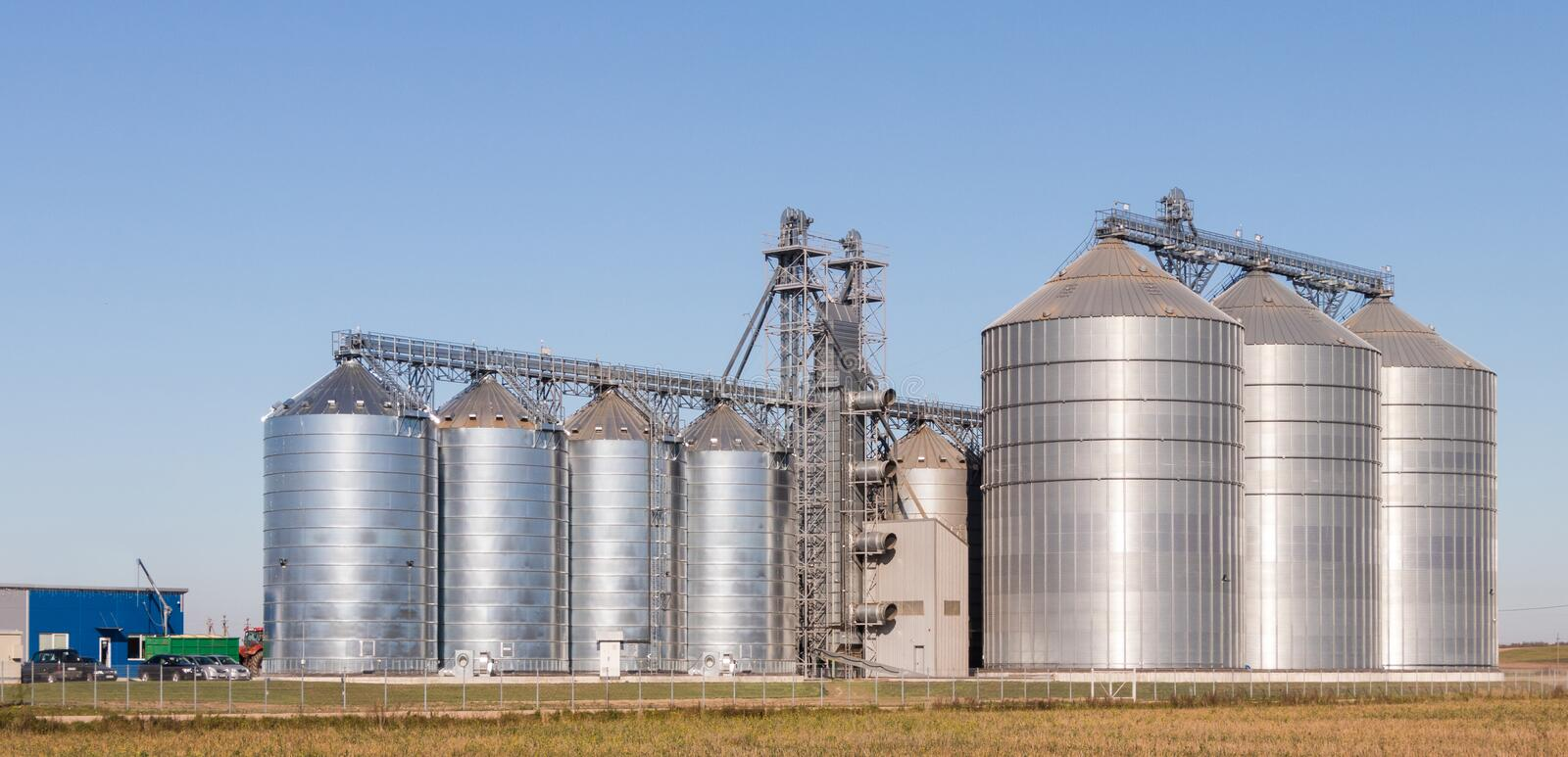 Agro-processing plant for processing and silos for drying cleaning and storage of agricultural products stock photos