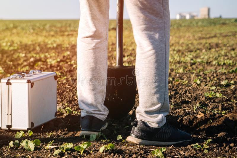 Agronomist checks the soil on the field royalty free stock photos