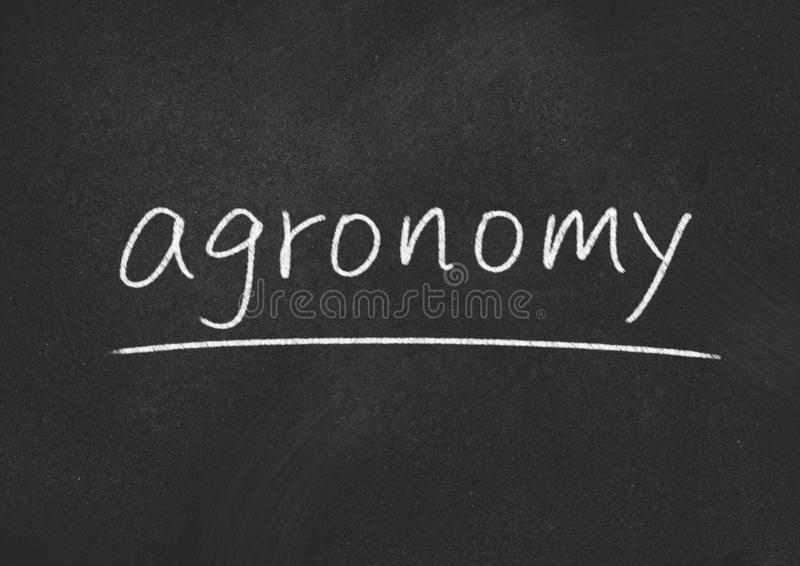 Agronomy. Concept word on blackboard background royalty free stock photo
