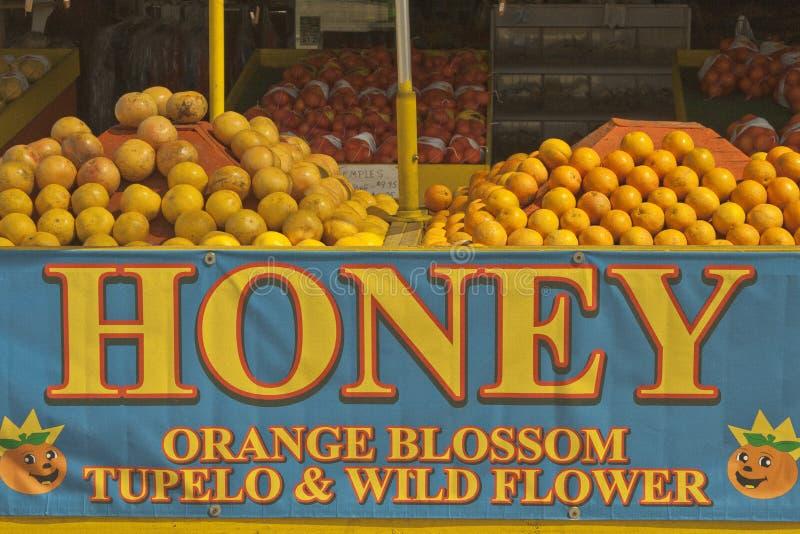 Agrumi e miele da vendere fotografia stock