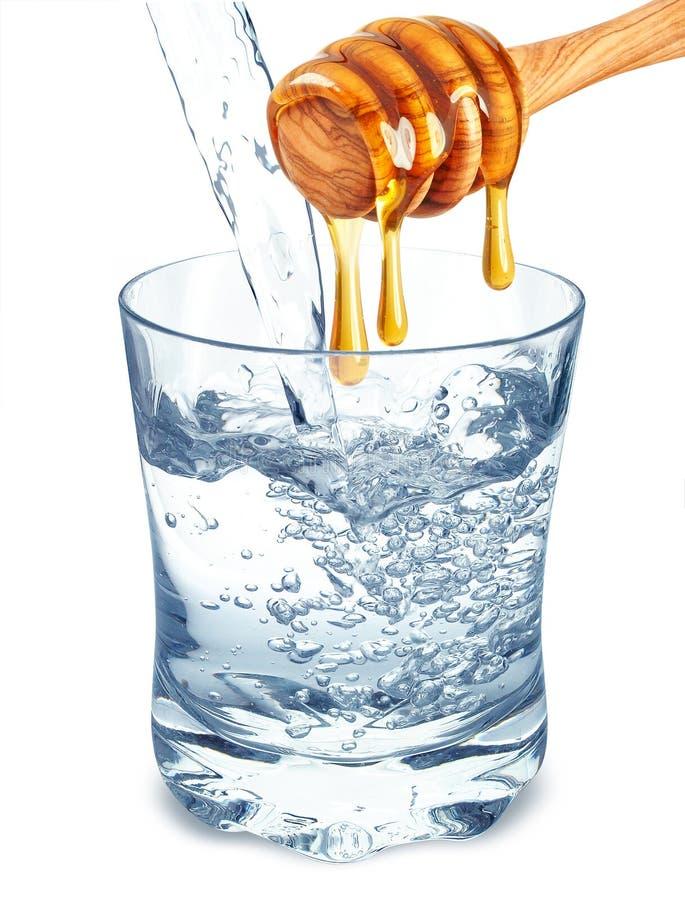 Agua con la miel imágenes de archivo libres de regalías