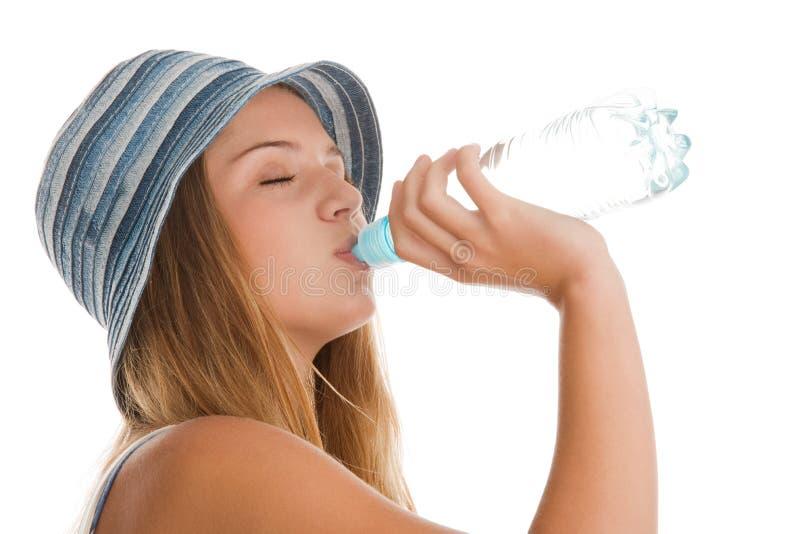 Agua potable de la mujer imagen de archivo libre de regalías