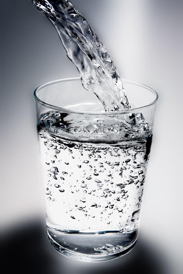 Agua vertida foto de archivo
