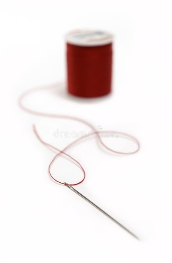 Aguja y cuerda de rosca. foto de archivo libre de regalías