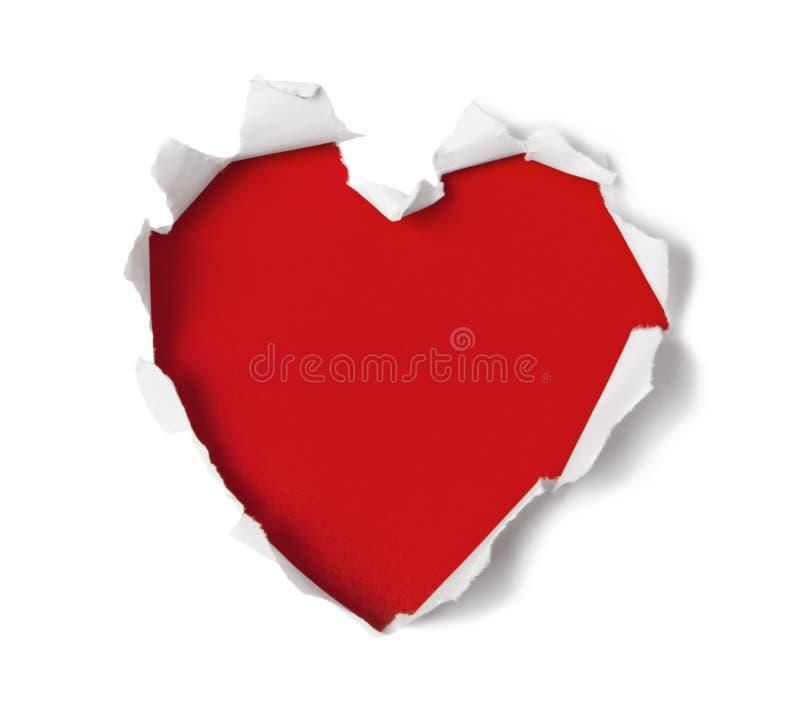 Agujero de la dimensión de una variable del corazón a través del papel fotografía de archivo libre de regalías