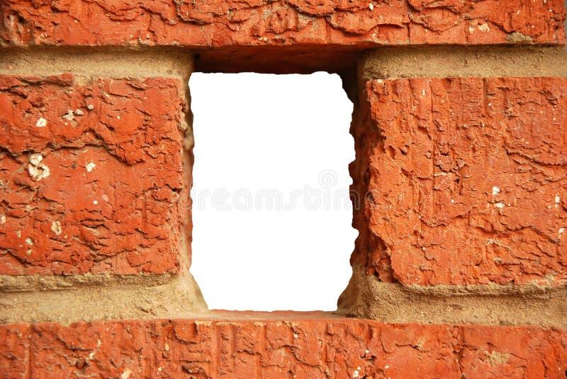 Agujero de la pared de ladrillo imagen de archivo