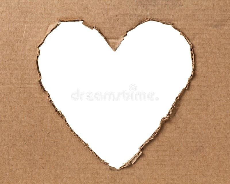 Agujero en una dimensión de una variable del corazón en la cartulina imagen de archivo libre de regalías