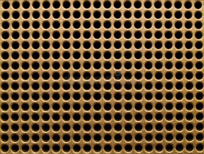 Agujeros de oro imagen de archivo