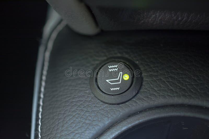 Agulheiro de assentos calorosos do ` s do carro fotografia de stock royalty free