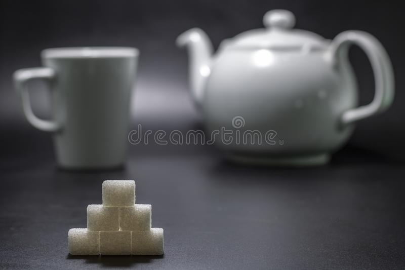 Ahead of sugar cube and porcelain mug in background. royalty free stock image