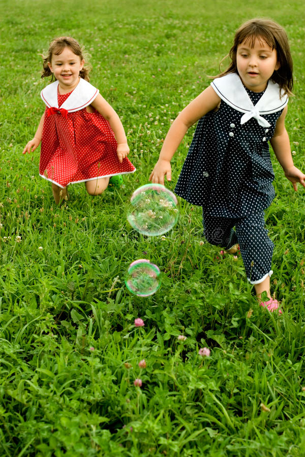 Download Ahhh To Be Young... Chasing Bubbles Stock Photo - Image: 13034348