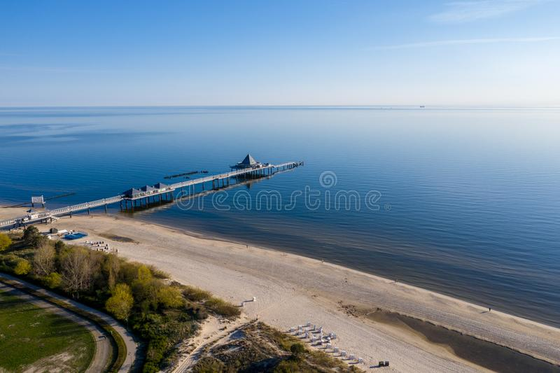 A drone flies over the sea bridge of Ahlbeck stock photography