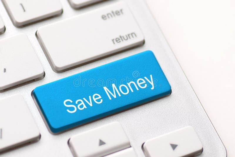 Ahorre la llave del botón del dinero imagenes de archivo