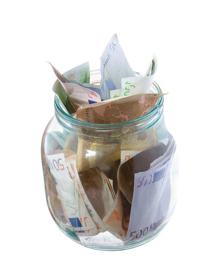 Ahorros en un tarro aislado en blanco imágenes de archivo libres de regalías
