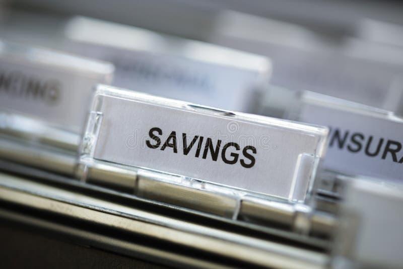 Ahorros que dirigen en cabinete de archivo fotografía de archivo