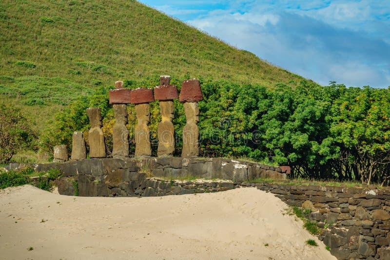 Ahu Nau Nau Moais looking to Rapa Nui. Ahu Nau Nau rear view of Moais in Anakena beach looking to Easter Island royalty free stock photography