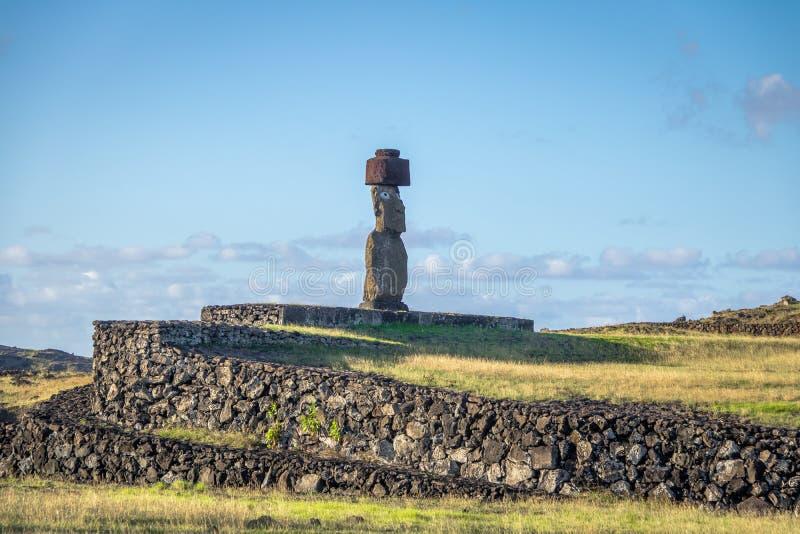 Ahu Tahai Moai Statue wearing topknot with eyes painted near Hanga Roa - Easter Island, Chile. Ahu Tahai Moai Statue wearing topknot with eyes painted near Hanga stock photos