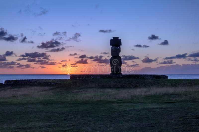 Ahu Tahai Moai Statue wearing topknot with eyes painted at sunset near Hanga Roa - Easter Island, Chile royalty free stock images