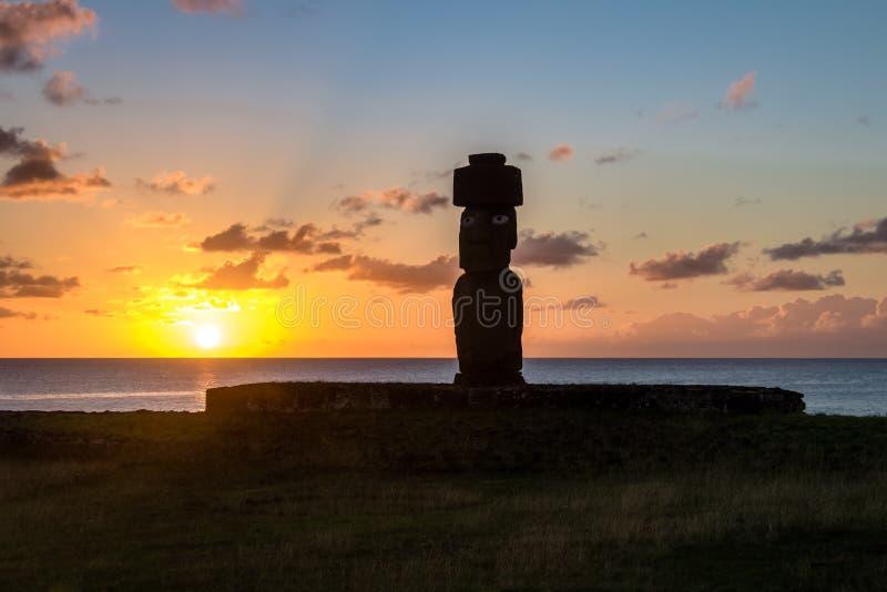 Ahu Tahai Moai Statue wearing topknot with eyes painted at sunset near Hanga Roa - Easter Island, Chile. Ahu Tahai Moai Statue wearing topknot with eyes painted royalty free stock photos