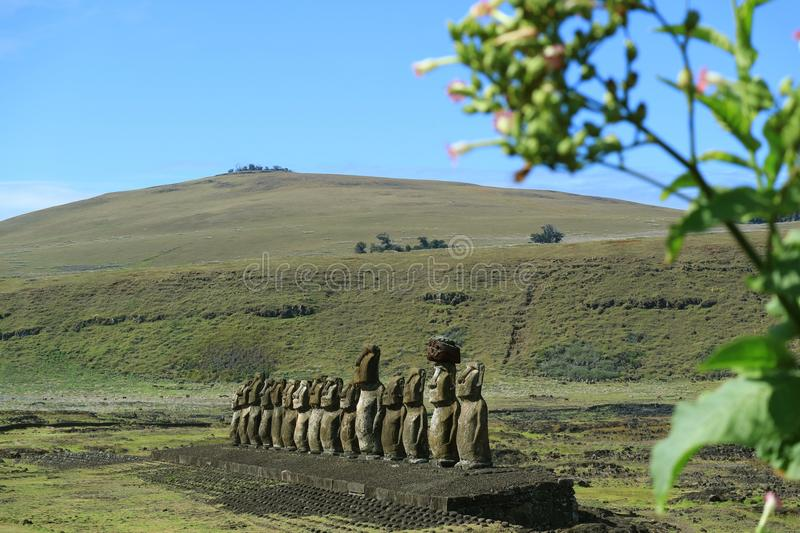 Ahu Tongariki Moai Ruin with Poike volcano on background, Easter Island or Rapa Nui, Chile stock photo