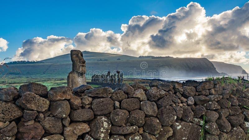 Ahu Tongariki Moais behind the stone fence. At dawn royalty free stock photo