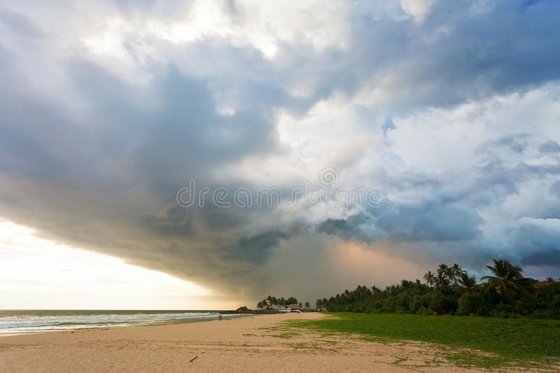 Ahungalla Beach, Sri Lanka - Impressive clouds and light during. Ahungalla Beach, Sri Lanka, Asia - Impressive clouds and light during sunset at the beach of royalty free stock images