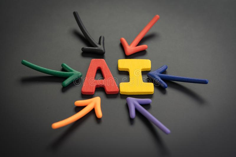 AI Artificial Intelligence concept, colorful arrows pointing to the alphabet combine acronym AI at the bright center on dark and stock images