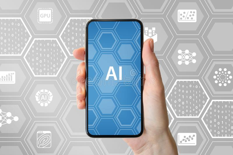 AI / artificial intelligence concept. Hand holding modern frameless smartphone in front of neutral background with icons.  stock images