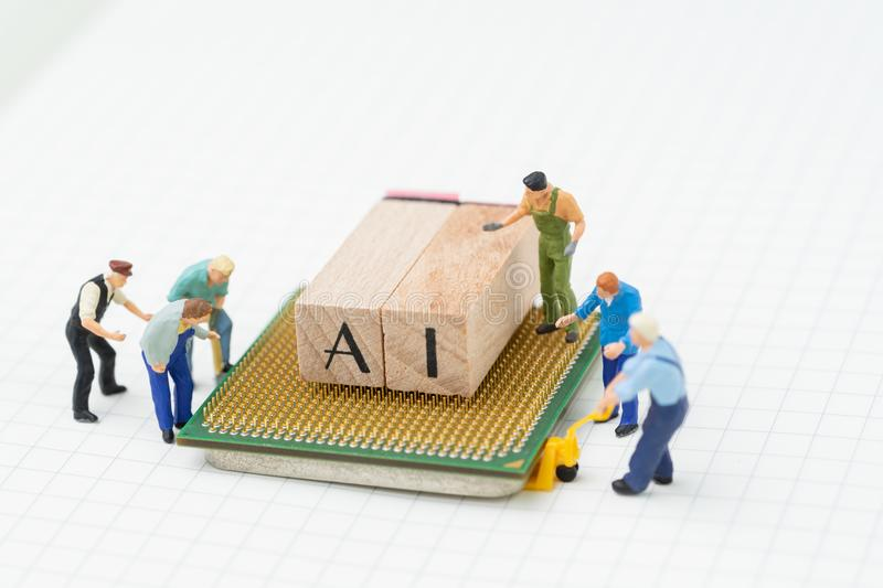 AI or Artificial Intelligence concept, miniature people figure, royalty free stock photos
