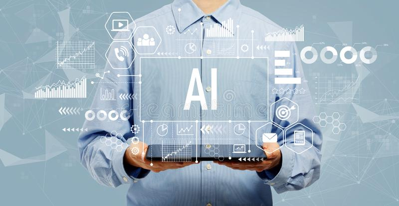 AI concept with man holding a tablet. AI concept with young man holding a tablet computer stock photography