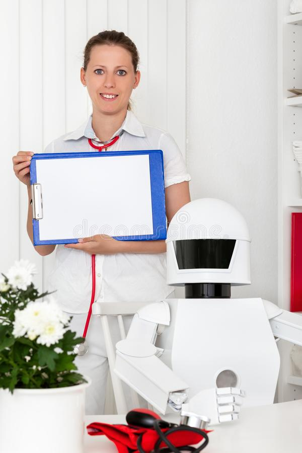 Ai robot as professional doctor in his office, sitting behind th. E desktop, nurse or second female doctor with clipboard in her hands royalty free stock photography
