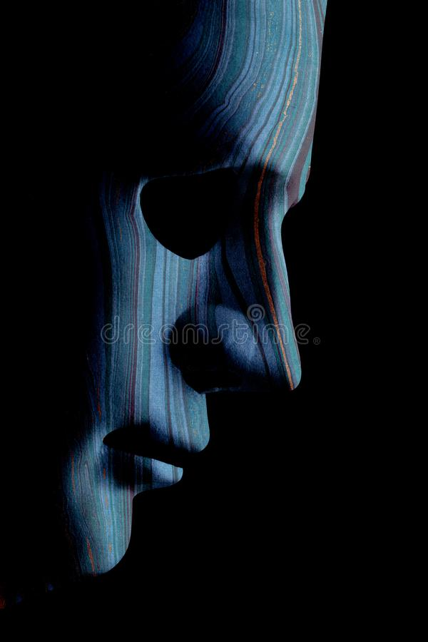 AI robotic face profile close up with contour lines. Robot face mask side view close up with textured skin and blank eyes. Black background and space for text royalty free stock images