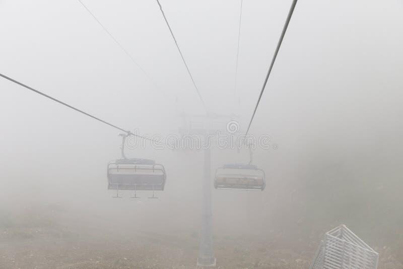 Aibga Ridge. Mountain Kamennyy stolb. 2509m. Mountains near the ski resort. cable car on the mountain going into the fog royalty free stock images