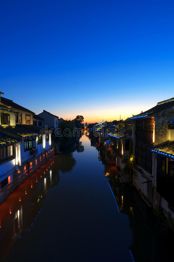Aicent town of Jiangsu China, shaxi. Shaxi, an aicent town in Suzhou Jiangsu China. Image was shooted after sunset, on a bridge over a river. The buildings in stock image