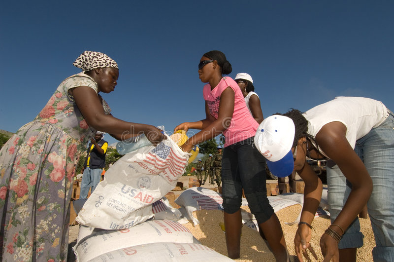Download Aid Recipients editorial stock image. Image of volunteers - 7516614