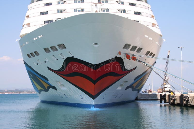 AIDA Cruise Ship. AIDA Diva Cruiseliner in the port of Heraklion, Greece. Logo is a smiling mouth/lips on the front and eyes on both sides of the ship royalty free stock image