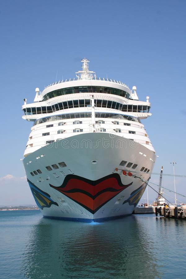 AIDA Cruise Ship. AIDA Diva Cruiseliner in the port of Heraklion, Greece. Logo is a smiling mouth/lips on the front and eyes on both sides of the ship stock photography