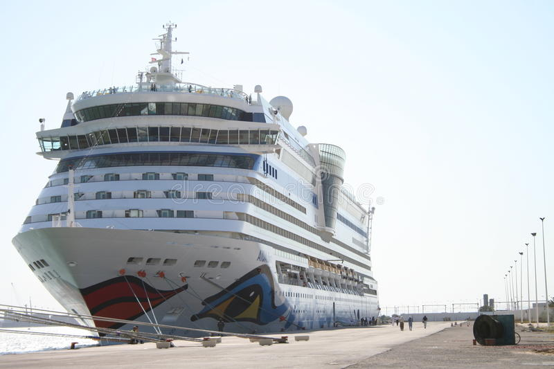 AIDA Cruise Ship. AIDA Diva Cruiseliner in the port of Tunis, Tunisia. Logo is a smiling mouth/lips on the front and eyes on both sides of the ship royalty free stock image