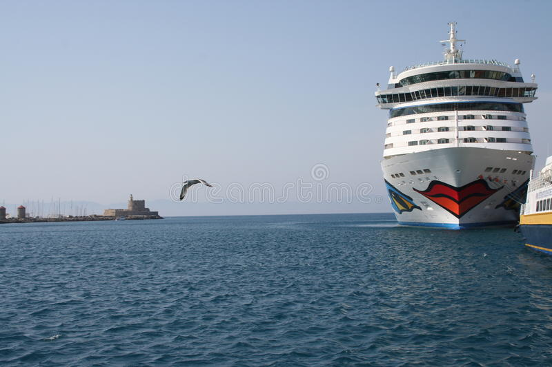 AIDA Cruise Ship. AIDA Diva Cruiseliner in the port of Rhodes, Greece. Logo is a smiling mouth/lips on the front and eyes on both sides of the ship royalty free stock photo