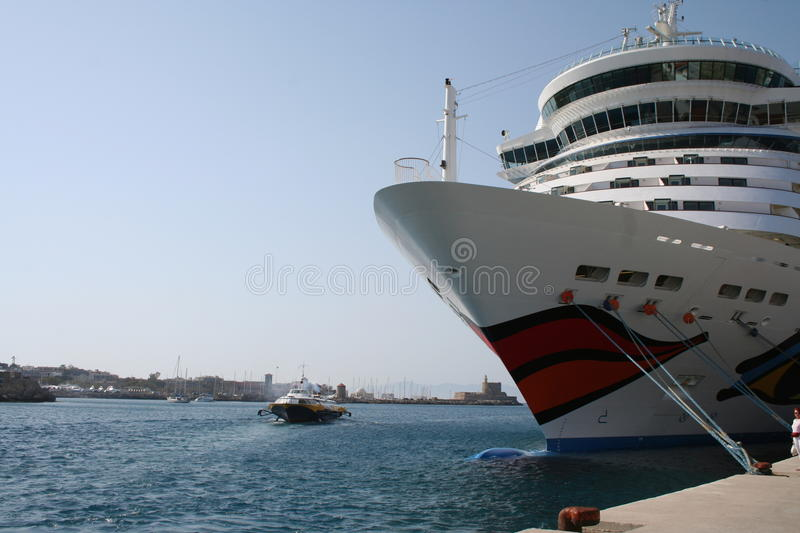 AIDA Cruise Ship. AIDA Diva Cruiseliner in the port of Rhodes, Greece. Logo is a smiling mouth/lips on the front and eyes on both sides of the ship stock photography