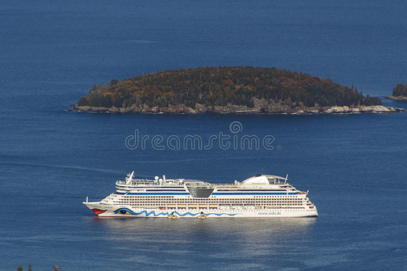 AIDA Dive Cruise Ship in Bar Harbor, USA, 2015. The cruise ship AIDA Diva with it's characteristic logo of lips and eyes on both sides of the ship in the bay of stock images