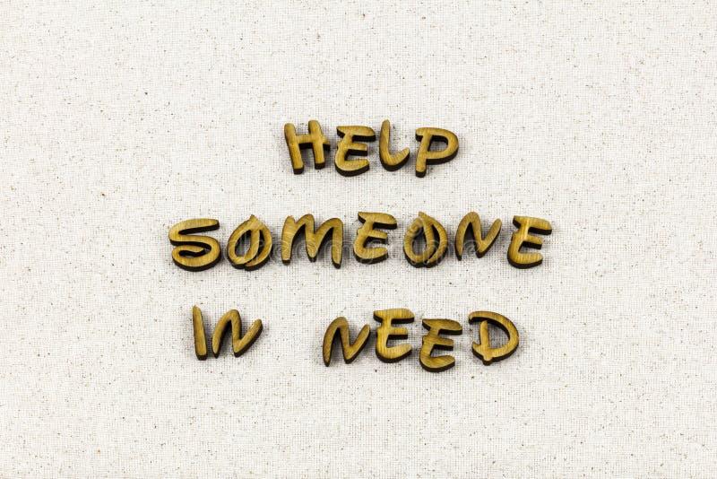 Aide avoir besoin de quelqu'un mot aimable de typographie de charité de gentillesse photo stock