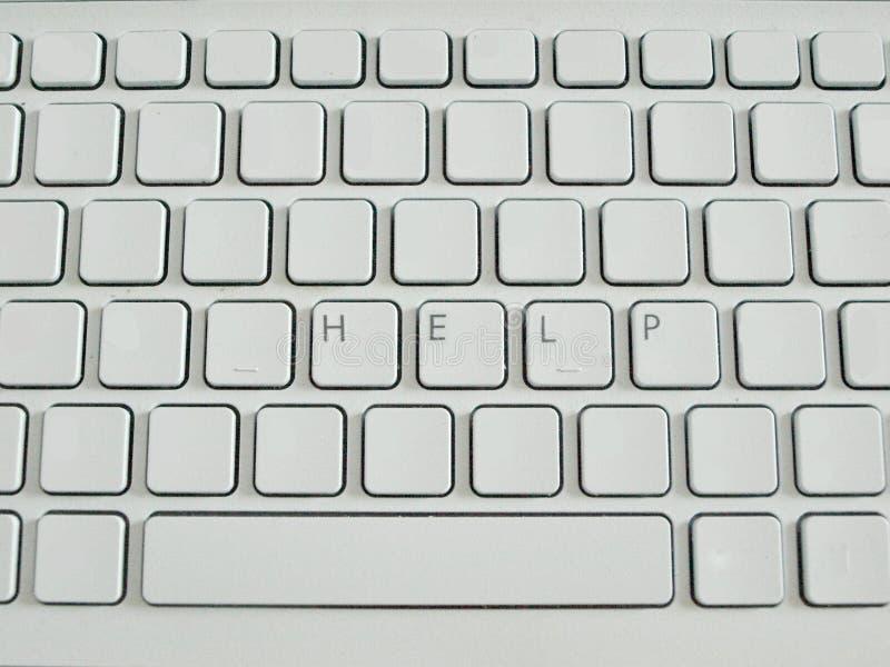 Aide de mot sur le clavier blanc photographie stock