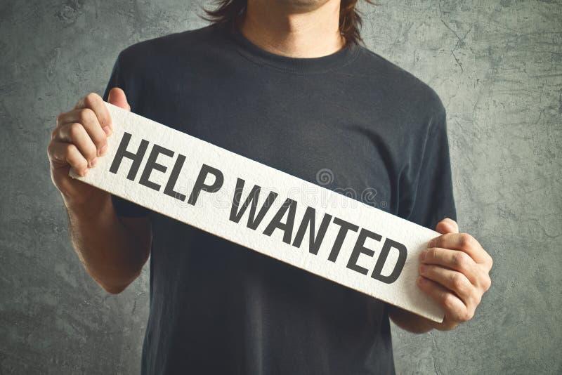 Aide voulue. Homme occasionnel demandant l'aide. photographie stock libre de droits