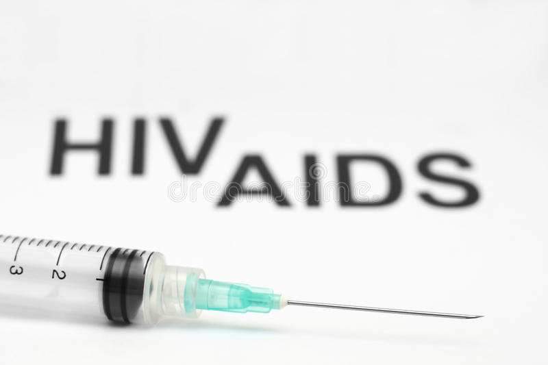 Aids. Close up of syringe against aids background royalty free stock photo